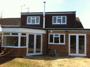 Brick extension with double glazed windows and white trimmed double doors and windows